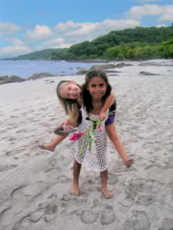 Two local kids playing on Montezuma Beach